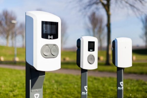 Image of three EVE commercial electric vehicle charging points in a car park